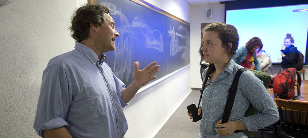 student talking with Professor Chiasson